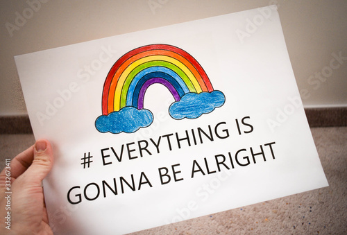 Everything will be fine, is gonna be alright in hand drawing letters and a rainbow with clouds drawn by a child Wallpaper Mural