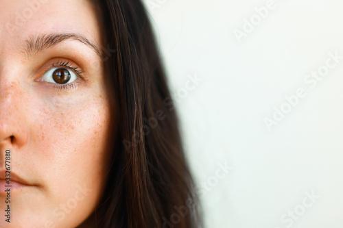 Fototapeta close up portrait of a woman half face obraz na płótnie