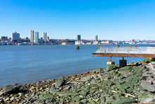 Waterfront Along The Hudson River In Lincoln Square Of New York City With A Clear Blue Sky