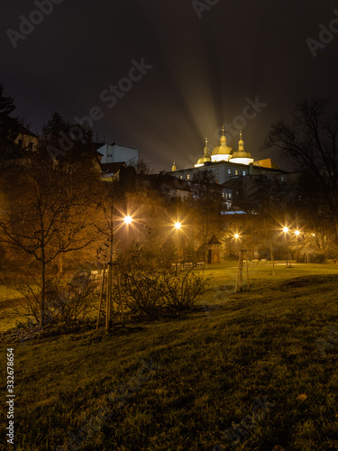 Church of Saint Michael in Olomouc with a park allay at night Wallpaper Mural