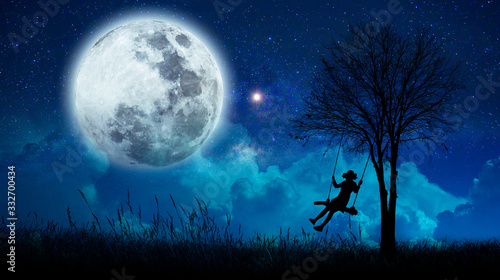 Fototapeta księżyc   imagination-the-girls-are-cradling-amidst-many-stars-and-full-moon-at-night