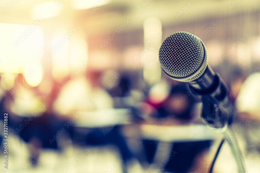 Fototapeta Microphone voice speaker in business seminar, speech presentation, town hall meeting, lecture hall or conference room in corporate or community event for host or townhall public hearing