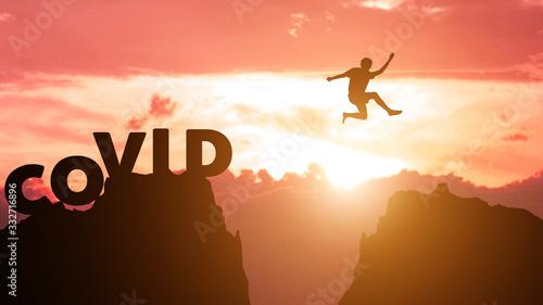 Valokuvatapetti Silhouette man jumps to survive from corona virus , COVID-19