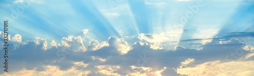 The background of sun rays over clouds. The sun rays break over the clouds.