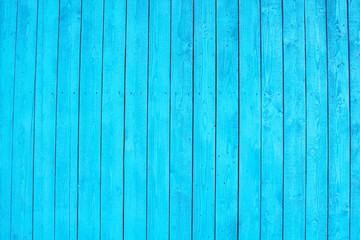 Old painted wooden boards in blue. Close-up. Vertical view. Background. Texture.