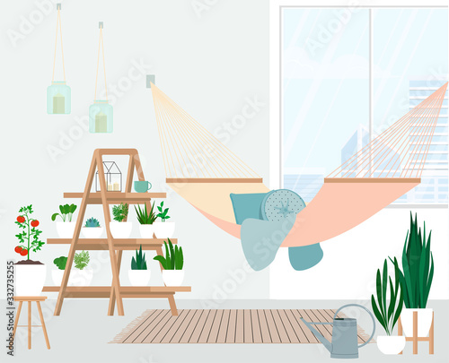 Hammock on the balcony in the urban mini garden. Canvas Print