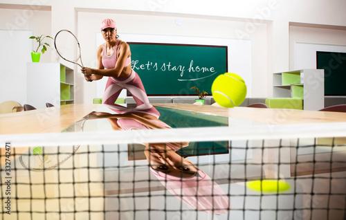 Obraz Let's stay home. Quarantine. Female tennis player. Sport concept - fototapety do salonu