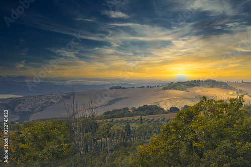 2020-03-01 A DRAMATIC SUNSET OVER A VALLEY IN THE TUSCANY REGION OF ITALY