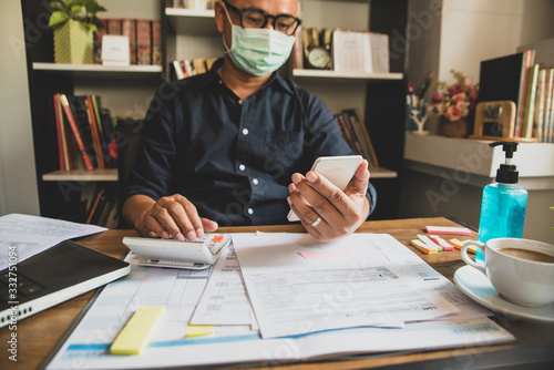 Fotografía Budget planning concept,Accountant wear mask is calculating company's annual tax