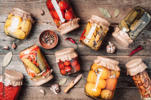 Сucumber, squash and tomatoes pickling and canning into glass jars Fototapete