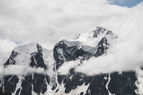 Obraz na plátně Atmospheric minimalist alpine landscape with massive hanging glacier on snowy mountain peak