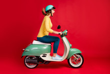 Profile Side View Of Her She Nice Attractive Lovely Amazed Cheerful Cheery Girl Driving Moped Having Fun Time Fast Speed Motion Motivation Isolated On Bright Vivid Shine Vibrant Red Color Background
