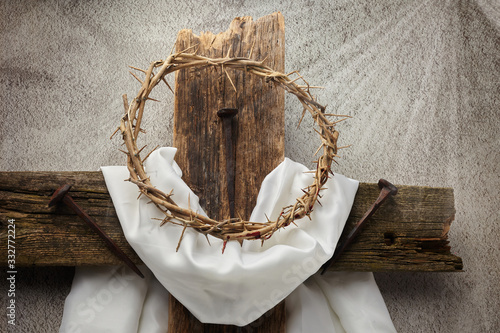 Fototapeta Easter background depicting the crucifixion with a rustic wooden cross, crown of thorns and nails. obraz