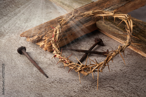 Easter background depicting the crucifixion with a rustic wooden cross, crown of thorns and nails Fototapeta