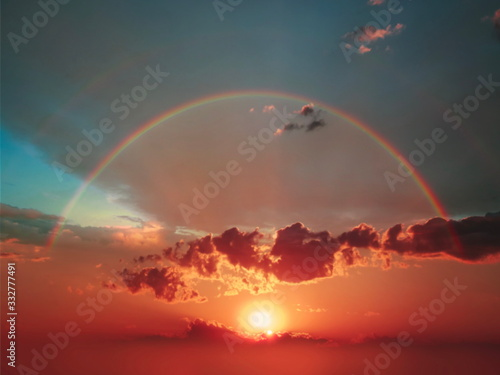 sunset and  colorful rainbow at blue cloudy sky beautiful nature summer sun light   gold pink blue dark  sunset background