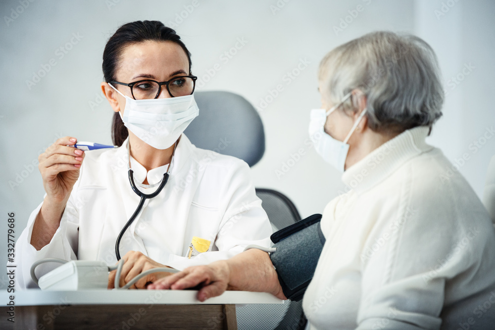Fototapeta healthcare in hospital concept. female doctor consulting old lady