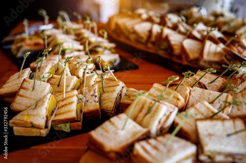 Fototapeta A lot of snacks sandwiches on event catering. obraz