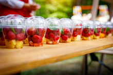 Glasses With Fruits On A Wooden Table. Summer Mood.