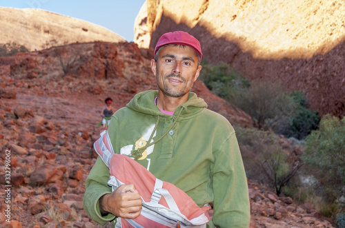 Male tourist visiting australian outback and dry landscape of Northern Territory Wallpaper Mural