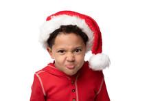 Little Boy In Santa Hat Making...