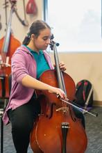Teenage Girl Playing Cello In ...