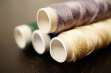 Closeup Shot Of Several Spools Of Thread Next To Each Other