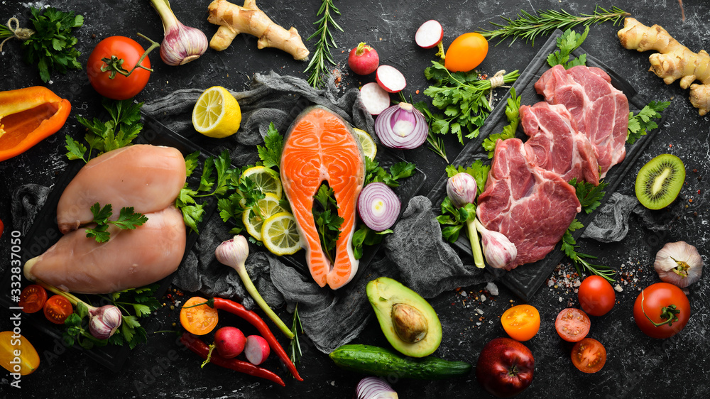 Fototapeta Protein Menu: Meat, Fresh Vegetables, Fruits, and Nuts. Healthy food on black stone background.