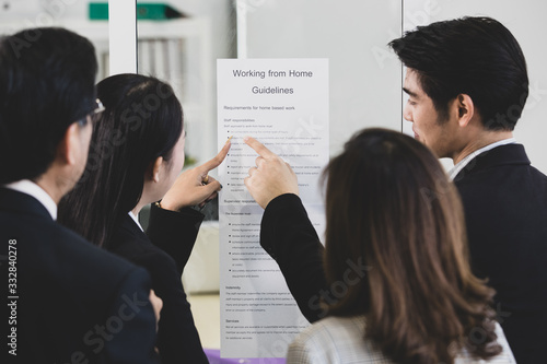 Businesspeople surrounded the placard board. Wallpaper Mural