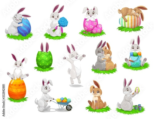 Fototapeta Easter cartoon rabbits with painted eggs isolated vector characters