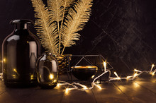 Fashion Elegant Retro Festive Home Decor In Dark Style - Warm Lights, Vases, Candlestick, Gold Glittering Feather In Bowl On Black Table, Plaster Wall.