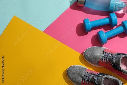 Valokuva Flat lay composition with fitness equipment on color background, space for text