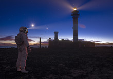 Astronaut Looking At The Lighthouse At Night
