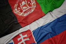 Waving Colorful Flag Of Slovakia And National Flag Of Afghanistan.