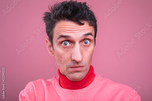 Fotografering Portrait of man with doubts on his face posing on camera
