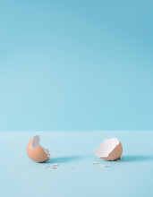 Empty Eggshell With Creative Copy Space On Pastel Blue Background. Minimal Easter Holiday Concept.