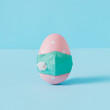 Leinwanddruck Bild - Creative composition with pink Easter egg and virus mask. Minimal Corona virus outbreak Holiday concept. Pastel fun background.