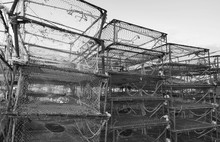 Box Shaped Crab Traps Stacked In Fishing Port