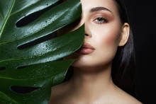 Beautiful Wet Girl In Palm Leaves. Natural Cosmetics