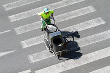 Street Sweeper Pushing A Cart ...
