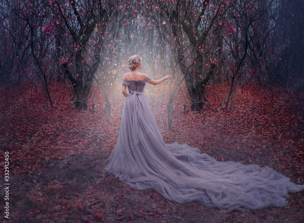 Fototapeta art photo young beauty woman queen. autumn purple mystic tree. fantasy entrance world magic divine glowing in dark deep forest. lady princess in elegant vintage dress, long train back medieval clothes