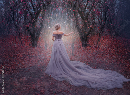 Obraz art photo young beauty woman queen. autumn purple mystic tree. fantasy entrance world magic divine glowing in dark deep forest. lady princess in elegant vintage dress, long train back medieval clothes - fototapety do salonu