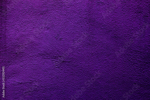 Purple colored abstract wall background with textures of different shades of purple or violet