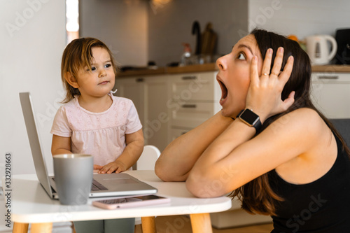 Stressed young woman working from home with small child Canvas-taulu
