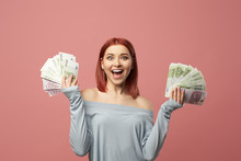 Smiling Young Woman Holding Euro Banknotes In Hands While Standing In Studio