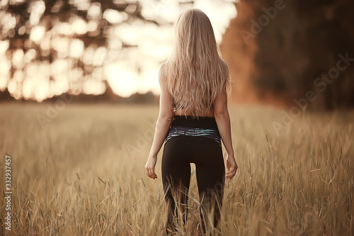 blonde long hair nature summer / happy adult girl with developing in the wind long blonde hair in the summer field #332937457