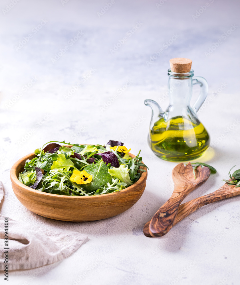 Fototapeta Salad from a fresh mix of leafy greens. Antiviral healthy food. Vitamins.