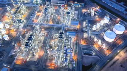 Large industrial estates of oil and gas refinery, Aerial view of industry plants, oil storage tanks and pipeline at night.