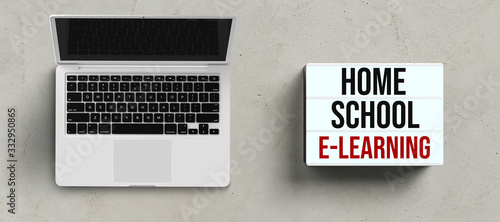 Fototapety, obrazy: laptop and lightbox with message HOME SCHOOL E-LEARNING on concrete background