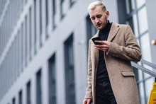Businessman Texting Messages W...