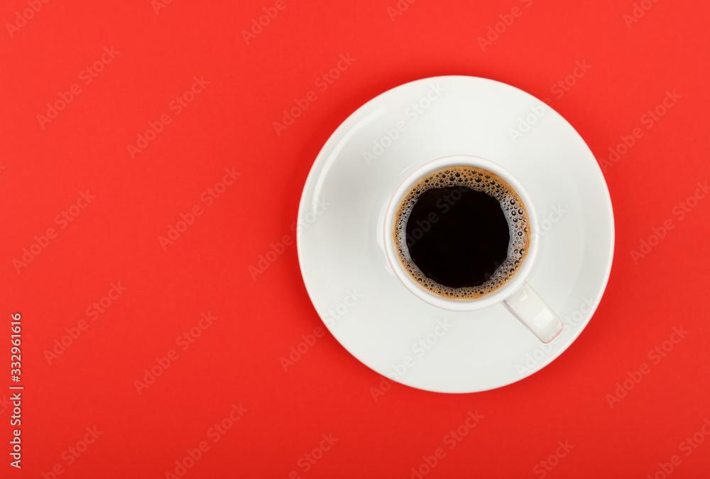 Fototapeta Full white espresso coffee cup over red